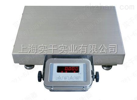 再把转换的电信号传送给电子电路;在称重时不要过力